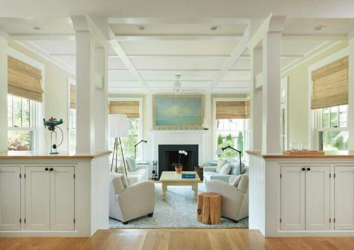 Sunken living room entry with built in cabinets and columns. Love it.