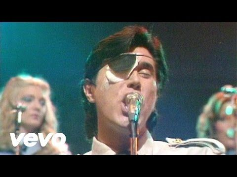 "Music video by Roxy Music 'Love Is The Drug.' ""I like Brain Ferry.  He can be really charming & really creepy at the same time.  He's like James Bond but a bit rapey."" -MrCool Mug"