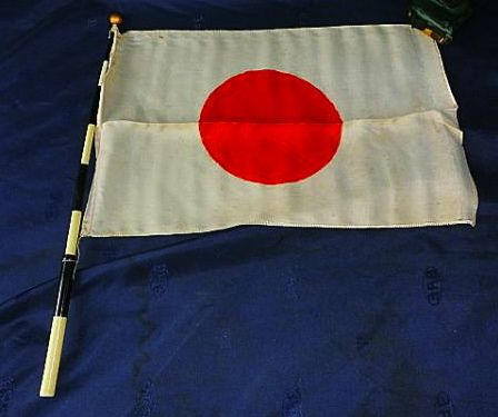 Student's patriotic hand held telescopic national flag. You will see other images on this board showing examples of children carrying this type of flag.