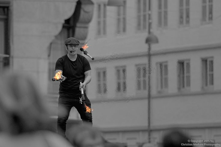 A fire juggler performing on Strøget in Copenhagen