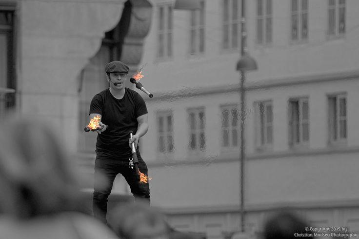 A fire juggler performing on Strøget in Copenhagen