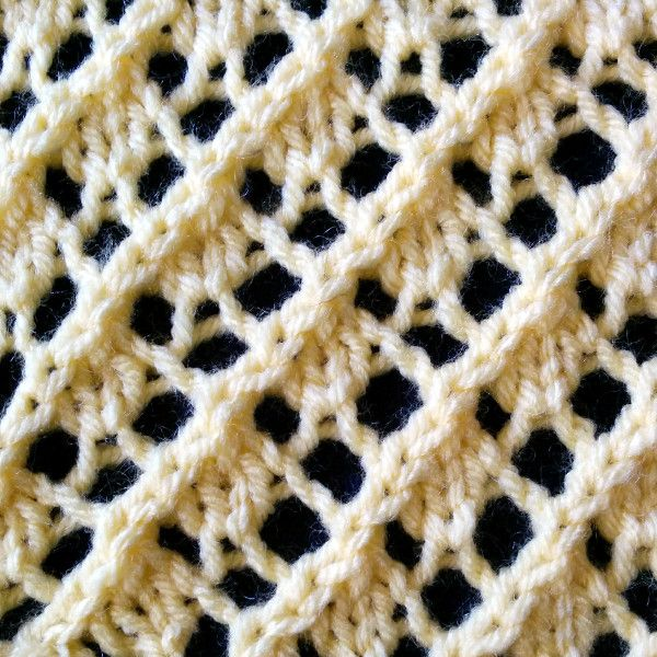 The Fancy Diagonal Lace stitch is a lace stitch that produces a right-leaning diagonal design running throughout the work. This stitch is an eight row repeat and is knitted in a multiple of four stitches plus five.