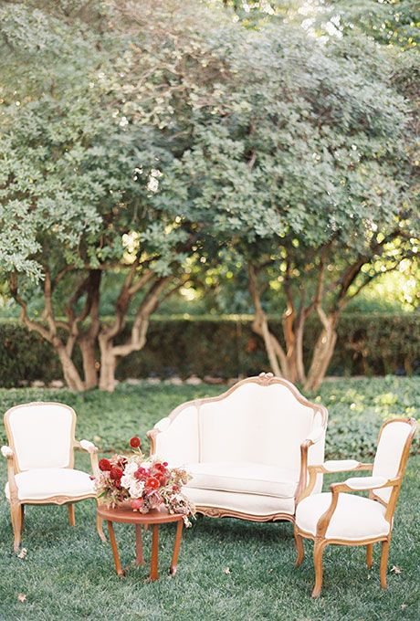 A classic lounge area with vintage-style furniture   Brides.com