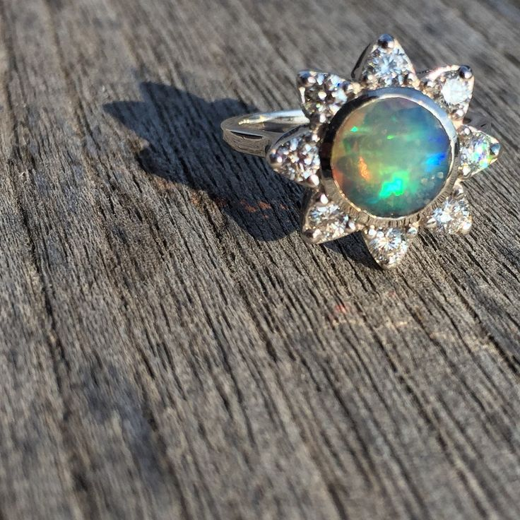 Stunning Welo opal surrounded by 80 pt of white diamonds set in 18K white gold. One of a kind, hand made ring.