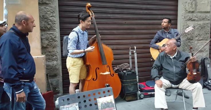 Korean tourist politely asks Italian street musicians if he can join them, absolutely kills it.