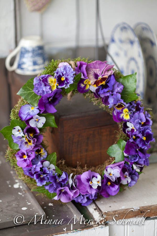 What a pretty pansy wreath by Blomsterverkstad