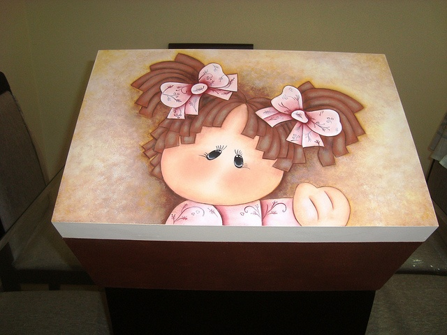 a handpainted girl on a wooden box.....oh so cute!!