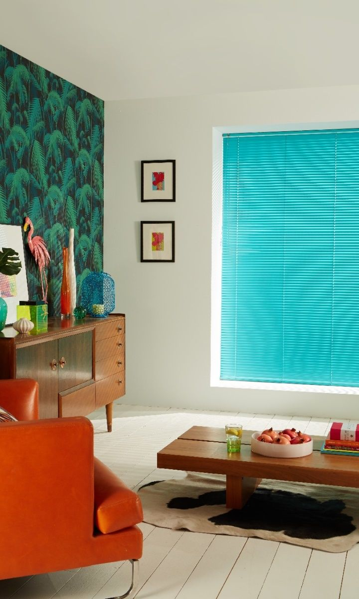 Tropical prints and bright colours make a perfect team. Match with retro style accessories to create a fun interior theme. Made to measure Aqua Metal Venetian blinds are perfect for this look.