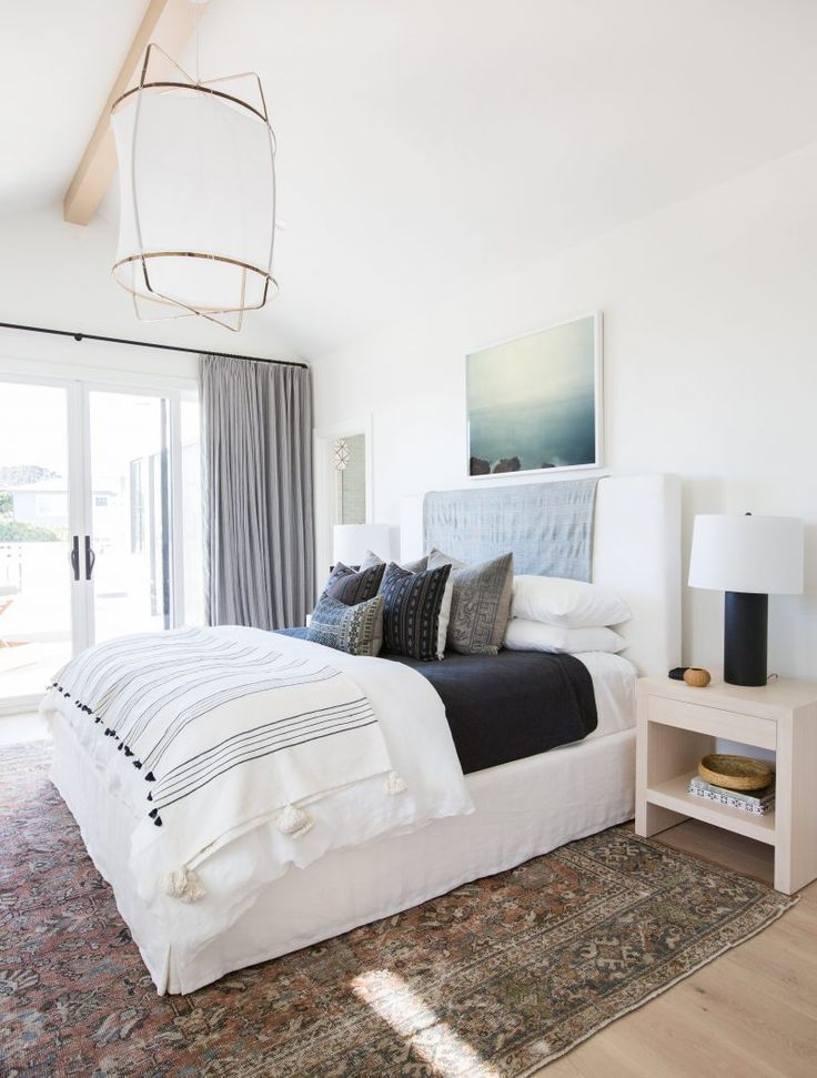 Patterned Rug White Walls Clean Light Bedding Love The Touches Of Detail And Color Amongst The Simpl Small Bedroom Remodel Remodel Bedroom Bedroom Interior