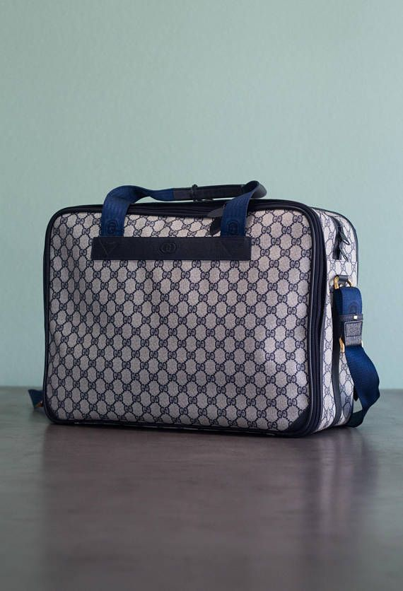 Vintage GUCCI designer luxury classic GG logo large carry-on travel luggage duffle bag in a navy blue/beige color-way. Please see photos for authentication as they are part of the description.