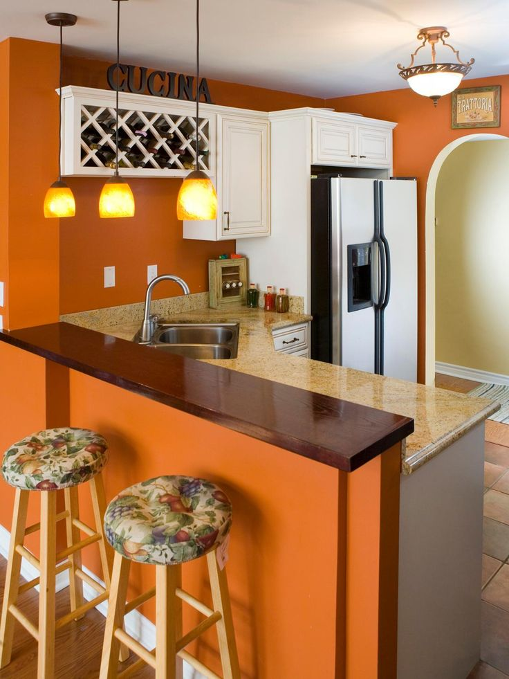 white brown colors kitchen breakfast. Pumpkin Orange Glossy White Cabinets Accentuate The Pumpkinorange Walls In This Inviting Kitchen Designed By Erica Islas Dark Brown Bar Top And Colors Breakfast S