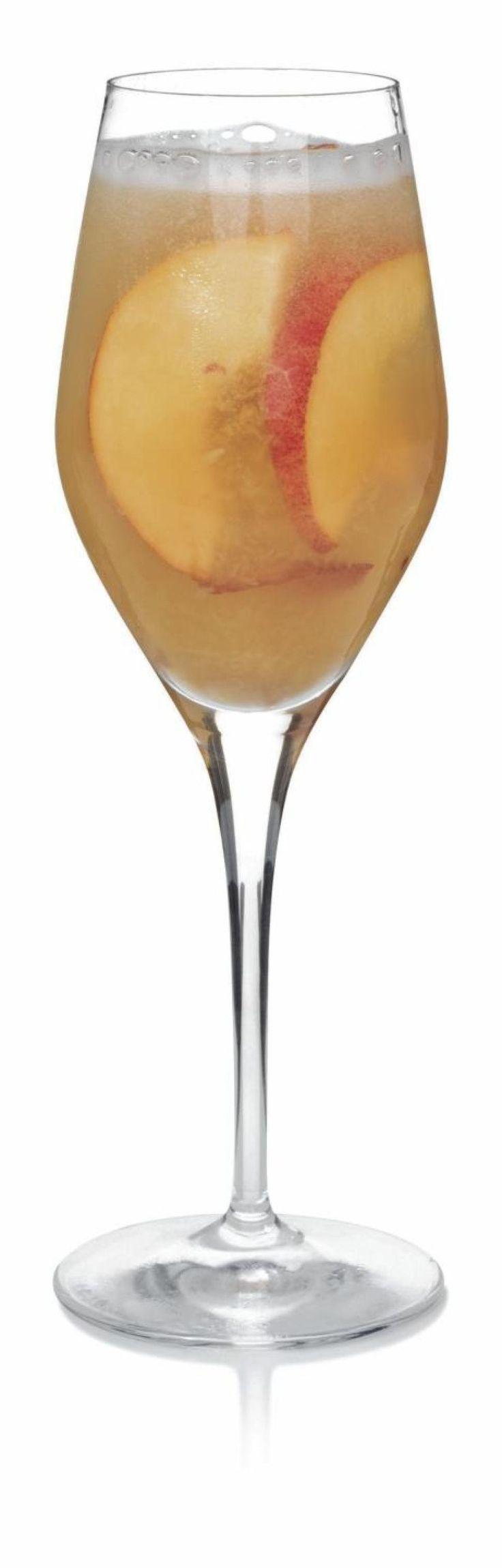 Slugger's Big Apple Sangria 1 bottle white wine 1 Red Delicious Apple, sliced 1/2 bottle chilled champagne