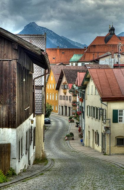 Bavaria, Germany village - This photo reminds me of the many villages we saw when we volksmarched in Germany. There is something very humbling about walking on a road or path that has survived, literally, centuries. This cobblestone road is possibly hundreds of years old!