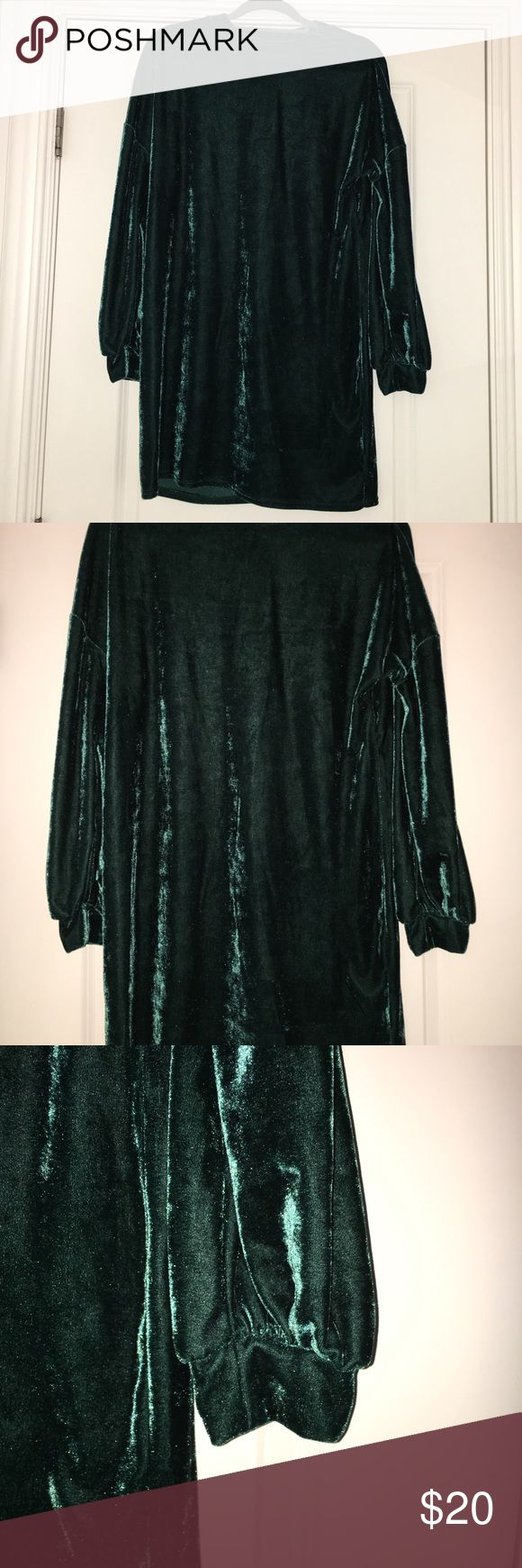 Long Sleeve Velvet Dress Gorgeous and trendy long sleeve velvet dress in an emerald green. Great to wear alone or later with tights or leggings. Only worn a couple times so still in great condition! Primark Dresses Long Sleeve