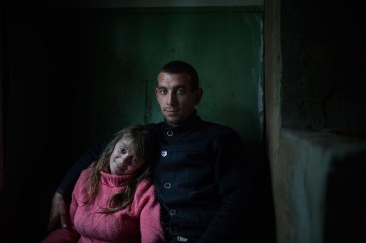 Valentina and Alexey Sergeev spend a weekend in one of Sergeev's employer's properties, a former Soviet-era river dispatching office, in the Ust'-Vologodskoye village, on the Vologda River, July 2015. Sergeev's employer owns local fleet and ports. The office used to serve a multitude of ships, but now there are plans to turn it into a museum of boats.