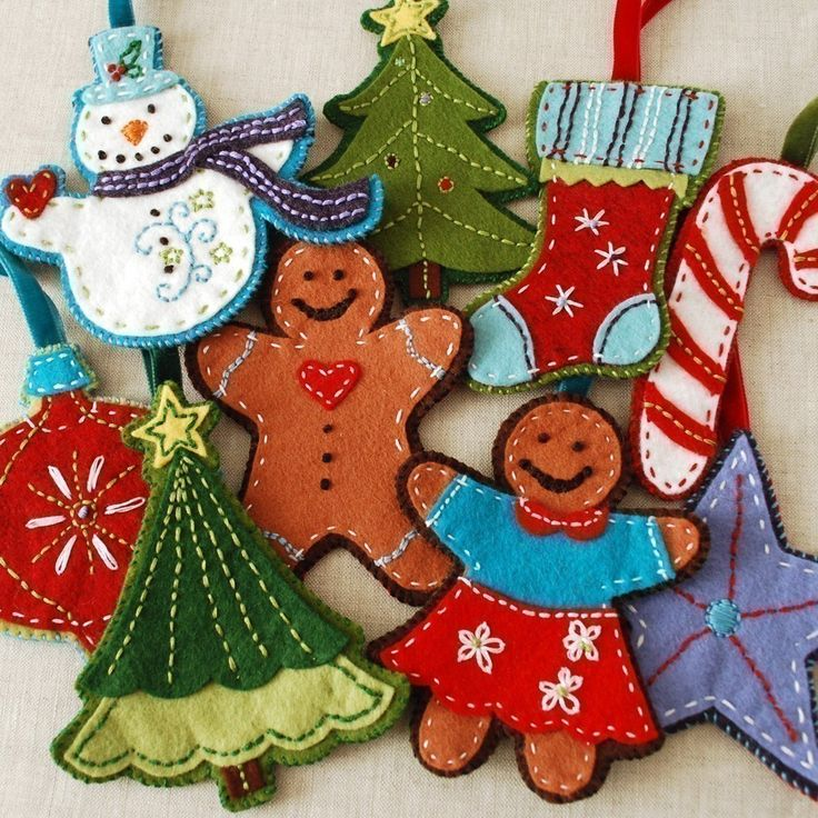 felt ornaments.. so cute! These felt guys remind me of the felt pieces my mom had on our tree skirt growing up!