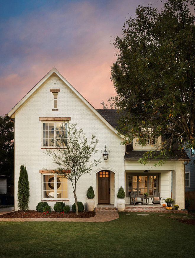 Off-white Brick Exterior Paint Color: Oyster White SW 7637 by Sherwin-William. Willow Homes.