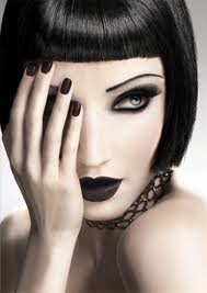 perfect bob, vamp polish, dead eyes. i don't like the brows, but any other shape would be uncalled for.