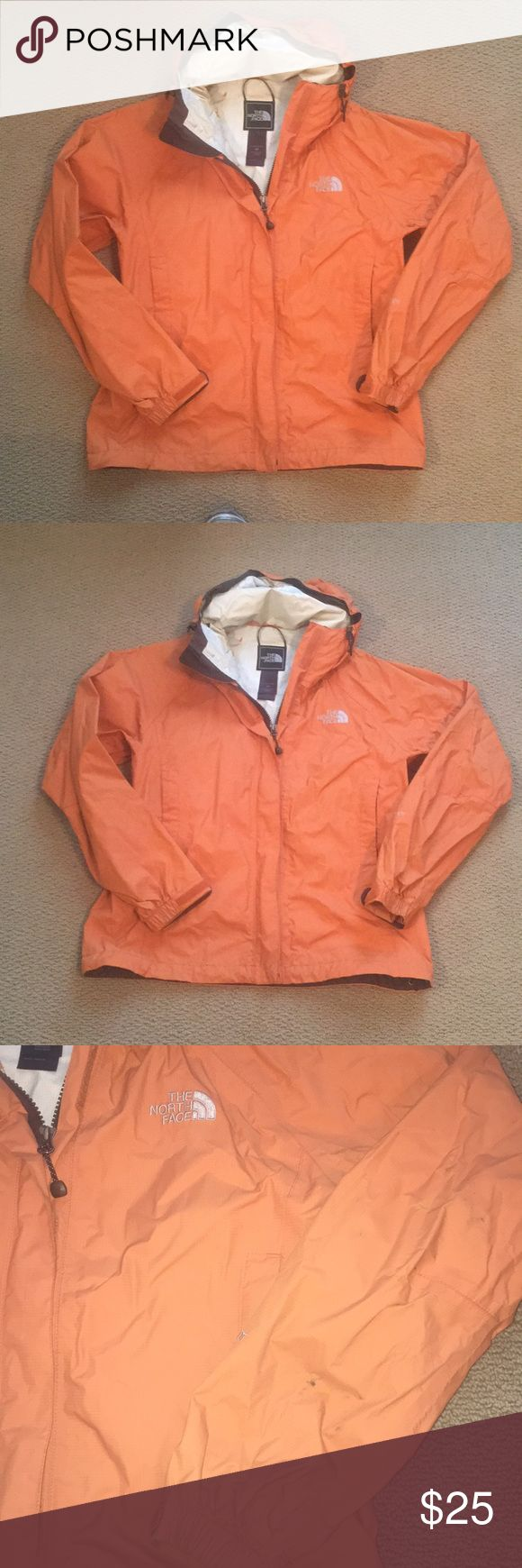 North Face Women's Rain Jacket North Face women's rain jacket, burnt orange color. Size small. Some dirt marks on sleeve, pictured. Good condition! North Face Jackets & Coats