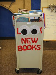 Look New Books! Library bulletin board. Library cart. Library sign signage. Googly eyes!