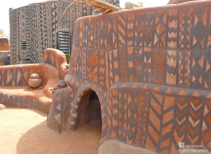 These are the earthen homes of the Gurunsi in Burkina Faso. You can see video via www.naturalhomes.org/timeline/gurunsi-house.htm The men build the house and the women decorate the facades. All the figures have a symbolic meaning. One of the ingredients used to waterproof the plaster is a by-product of shea butter [www.naturalhomes.org/naturalliving/shea-butter.htm] from the shea tree.