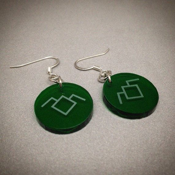 These earrings feature an etched symbol from my favorite cult television series of the 90s, Twin Peaks. If you are familiar with this series you will know the meaning of Owl Cave and this symbol. And while in Fire Walk With Me this symbol only appears on rings I thought since I had some green acrylic, why not?  If you need more than one pair, please let me know and I can create a custom listing for you. These would be perfect party favours for any Twin Peak events (marathons, festivals…