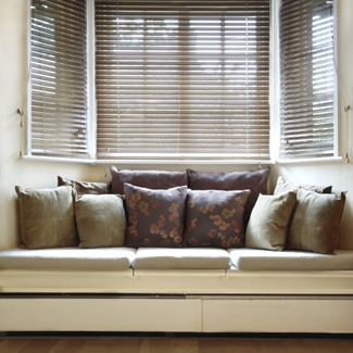 bay window idea - with pillows but I'd make each pillow different with lots of different colors.