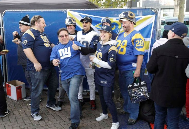 Giants vs. Rams in London:     October 23, 2016  -   17-10, Giants  -     A New York Giants supporter photobombs a photo set up by Los Angeles Rams fans before an NFL football game between the New York Giants and the Los Angeles Rams at Twickenham Stadium in London, Sunday Oct. 23, 2016.
