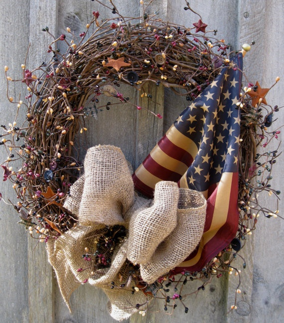 "July. Vine wreath wrapped with ""airy"" red, white & blue seed garland (might need to glue separate twigs to get that airy look). Spot with occasional button and tin star. Add bow & flag."