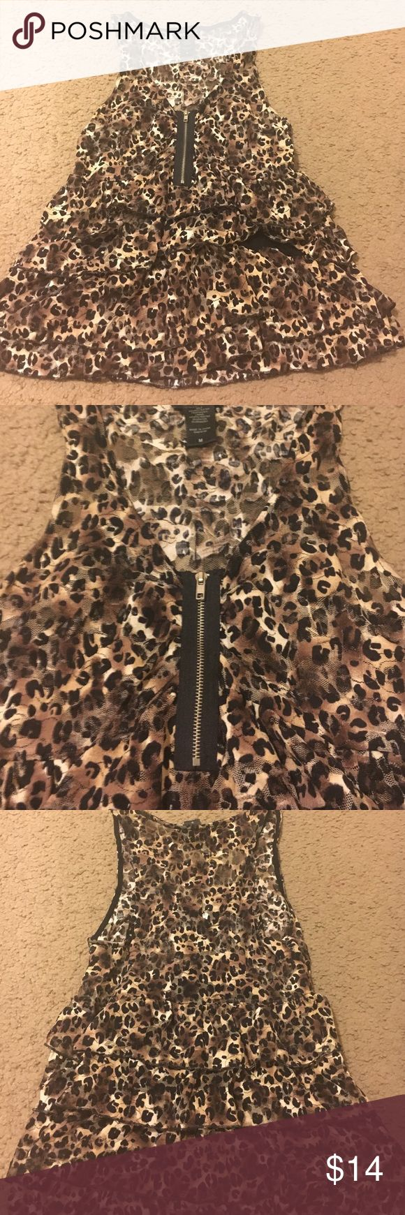 Wet seal Cheetah print shirt This is a gorgeous ruffle top that is most definitely see through! A bandeau is perfect to put underneath unless you're feeling a little risqué! Beautiful condition Wet Seal Tops