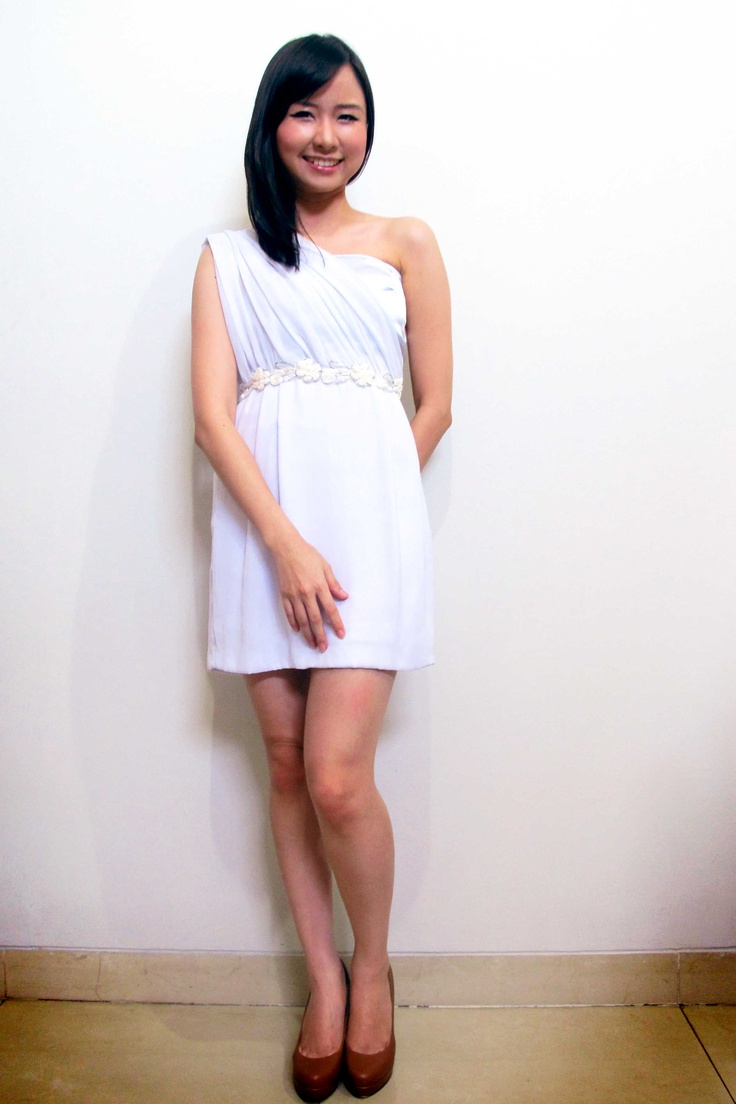 Miss M is wearing a little white dress with one shoulder. Gorgeous just like a Greek goddess.