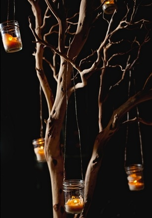 Mercury glass votives will hang from the branches in between hanging stock flowers.