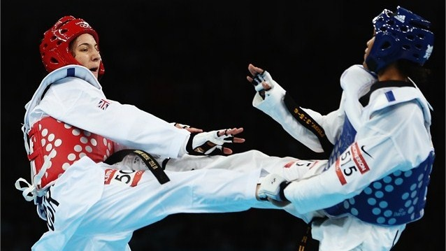 Sarah Stevenson of Great Britain competes against Paige Mcpherson of USA during the Women's -67kg Taekwondo Preliminary Round
