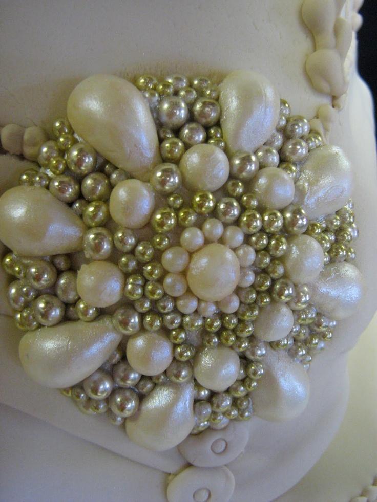 Sublime Bakery: Elegant Ivory Hexagonal Wedding Cake with Edible Sugar Brooch
