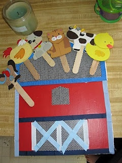 """By - 'The """"Unworking"""" Mom': Old McDonald Had a Farm. She got the animals at Hobby Lobby and just hot glued them to Popsicle sticks. The barn is scrapbook paper and ribbon - IShe used modge podge to adhere the paper to form board and than hot glued the ribbon on top of that...."""