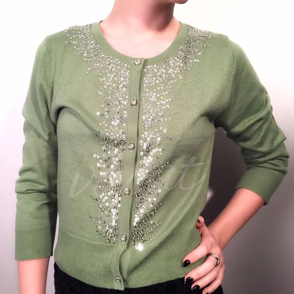 """Jaloux Green Sequin Cardigan Adorable green cardigan with silver sequins and clear beads. Perfect for upcoming holiday gatherings when paired with pencil skirt or silk trousers. ▪️55% acrylic, 30% wool, 15% viscose ▪️closes with 6 silver tone encased clear rhinestones ▪️thin lightweight Apprx measurements laying flat: ⚫️across shoulders: 14.5"""" ⚫️underarm-underarm: 17"""" ⚫️sleeve: 21"""" ⚫️length: 18"""" Upon scrutiny, there are a few sequins missing, but nothing that detracts Please compare…"""
