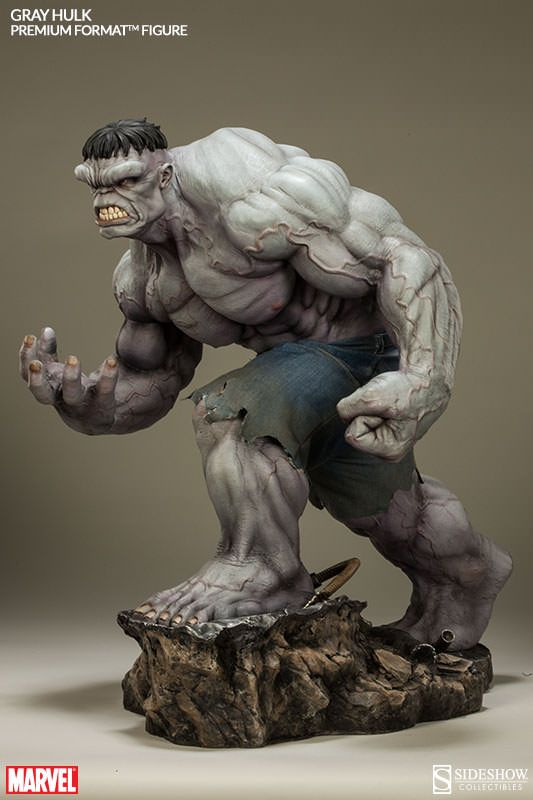 As you can see from the Gray Hulk Premium Format Figure, before he was mean and green, the Hulk was gray and... ummm... well, he was gray.  When the Hulk first appeared in 1962, the art of mass producing colored comics wasn't as refined as it is today. Stan Lee wanted the Hulk to be gray but he wa