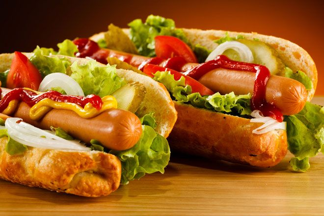 Hot dogs and bacon. Processed meats with nitrites are very dangerous. Hot dogs, bacon and your lunch meats piece that contain nitrites, can mix with the other ingredients in your stomach, and turn into carcinogenic.They are responsible for the spread of cancer.