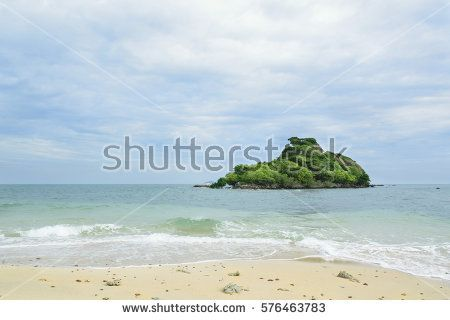 Sandy beach with island on the sea in Rayong, Thailand. Cloud and blue sky background.