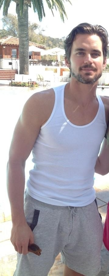 OMFG...Really? Officially the only man in history to look spectacular in a wife beater tank.
