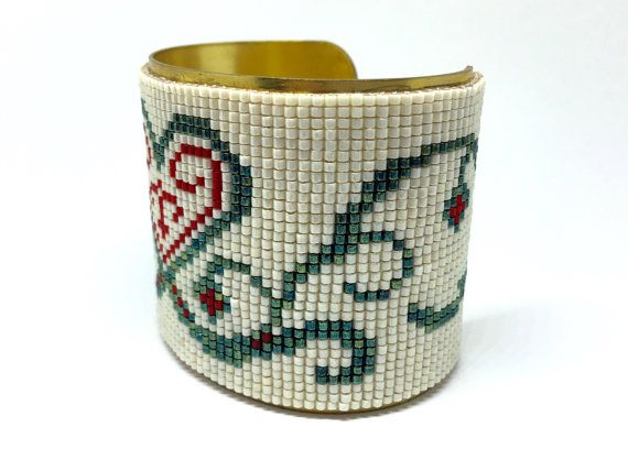 BE CAREFULL HOLIDAYS: ALL ORDERS FROM July 02 to July 24 will be shipped on july 25    Cuff Bracelet woven beads, red white, blue / green heart motif Tribal / christmas gift idea, birthday  Production: The realization of this bracelet 3:30 account work + 24 hours of complete drying.  - Weaving beads miyuki Delica 11/0 (2592 beads), 3 colors (white red, blue metallic green).  - Weaving is mounted on an open bracelet brass 49 mm (1.92inches) wide and 16 cm (6.29 inches) long.   T...
