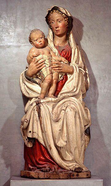 Jacopo della QUERCIA Sienne, vers 1374 - Sienne, 1438  La Vierge et l'Enfant  Provenant de la collection du cardinal Giordani à Rome, et peut-être auparavant du Carmel de Ferrare Bois polychrome H. : 1,77 m. ; L. : 0,73 m. ; Pr : 0,63 m.