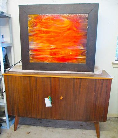 MCM mid century modern dresser with orange painting on top. This weekend's Westlake estate sale! Sept. 26-27.