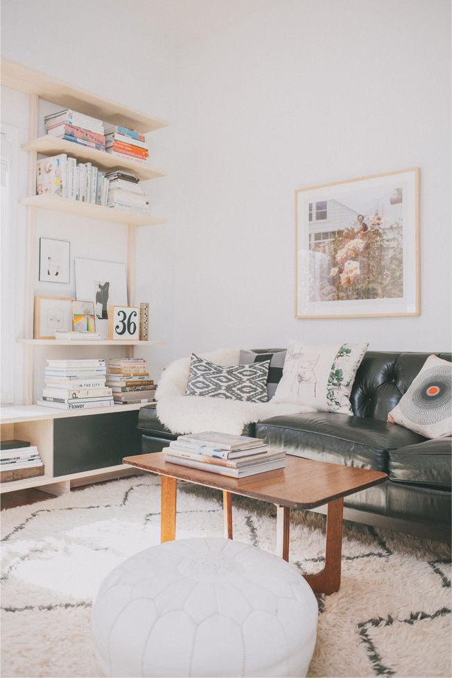 Victoria Smith of @sfgirlbybay / victoria smith // living room // black leather couch // grey throw pillows // wall art // bookshelf styling // photography by @Edyta Szyszlo