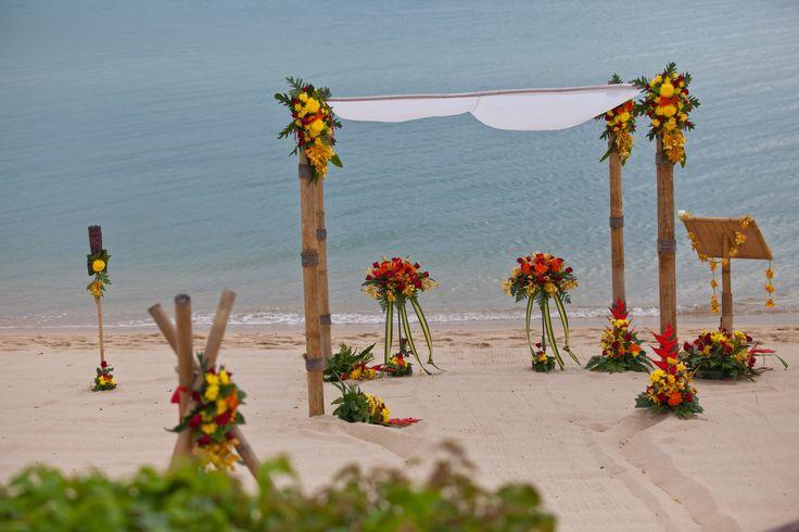 Red, yellow and orange beach wedding Weddings in Thailand.