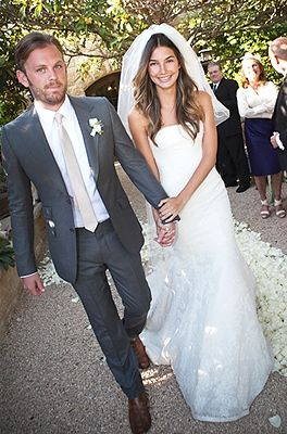 Grey suit with champagne tie.  This could be groom with groomsmen slightly darker, vice versa