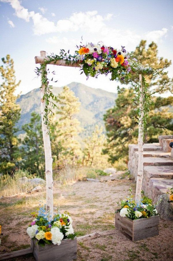 Beautiful birch poles create a gorgeous rustic wedding arch. | http://www.weddingpartyapp.com/blog/2014/10/22/stunning-wedding-arches-diy-buy/#more-31856