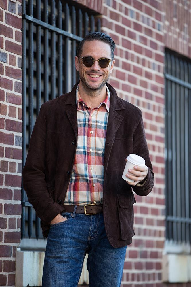 A flannel shirt, brown corduroy jacket, jeans and belt are a good combination.