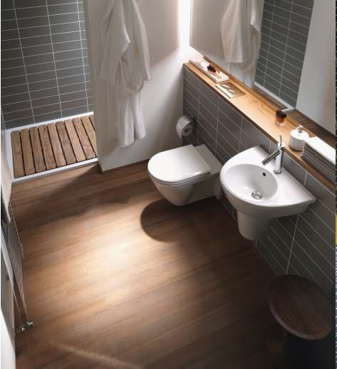 gorgeous modern bathroom. very soothing. grey tile, lovely wood, concealed toilet tank. i love the wood floor.
