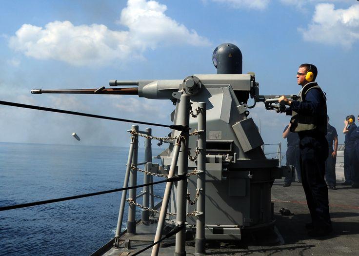 US Navy Gunner's Mate 2nd Class Michael Finch test fires a Typhoon ...